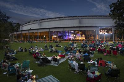 Tanglewood Shed with patrons sitting on the lawn for evening concert