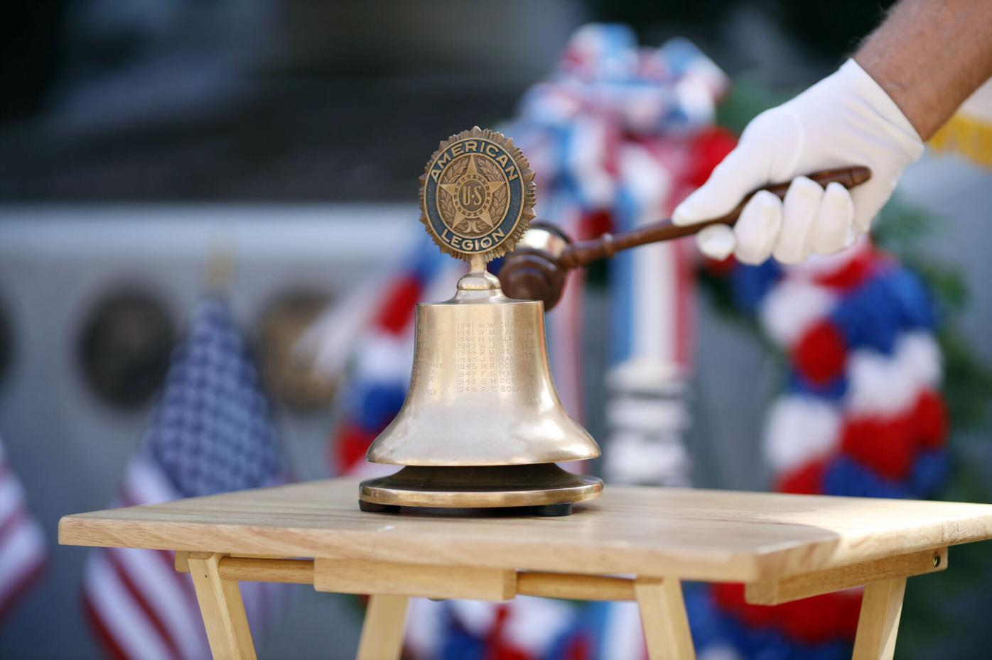 small memorial bell hit with mallet