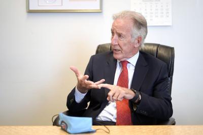 Richard Neal sitting at desk (copy)