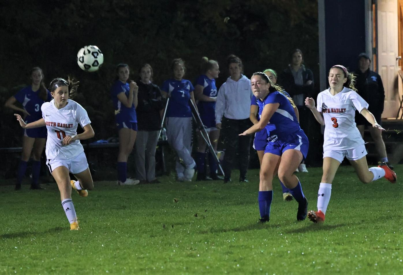 claire naef kicks a ball