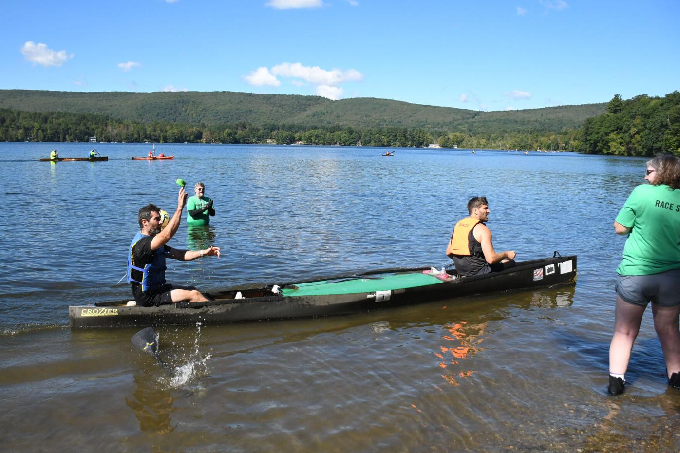 First-place paddlers toss their wristband to their runner