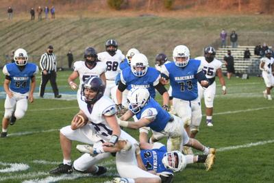 Patrick Rindfuss tackled by Brad Noyes