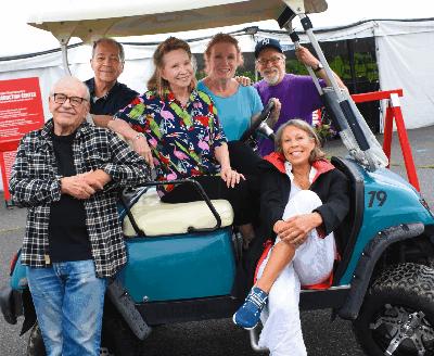 Boca cast in golf cart