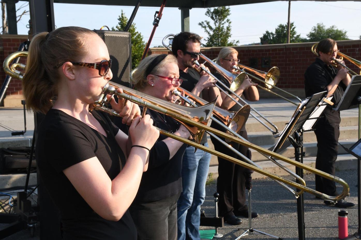 Five musicians play trombones