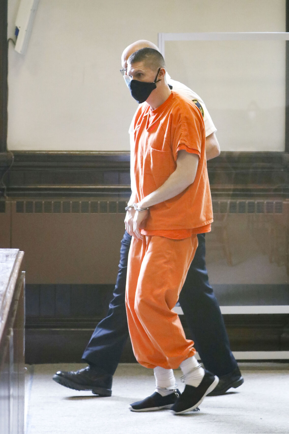 Edward Jennings led into court in orange jumpsuit and handcuffs