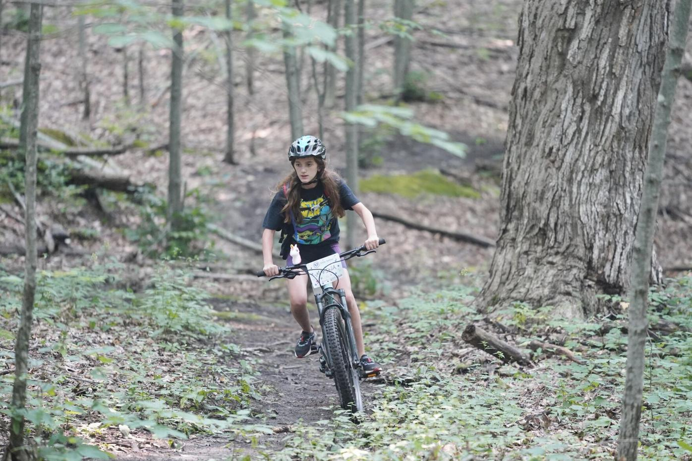 Young woman riding in the woods