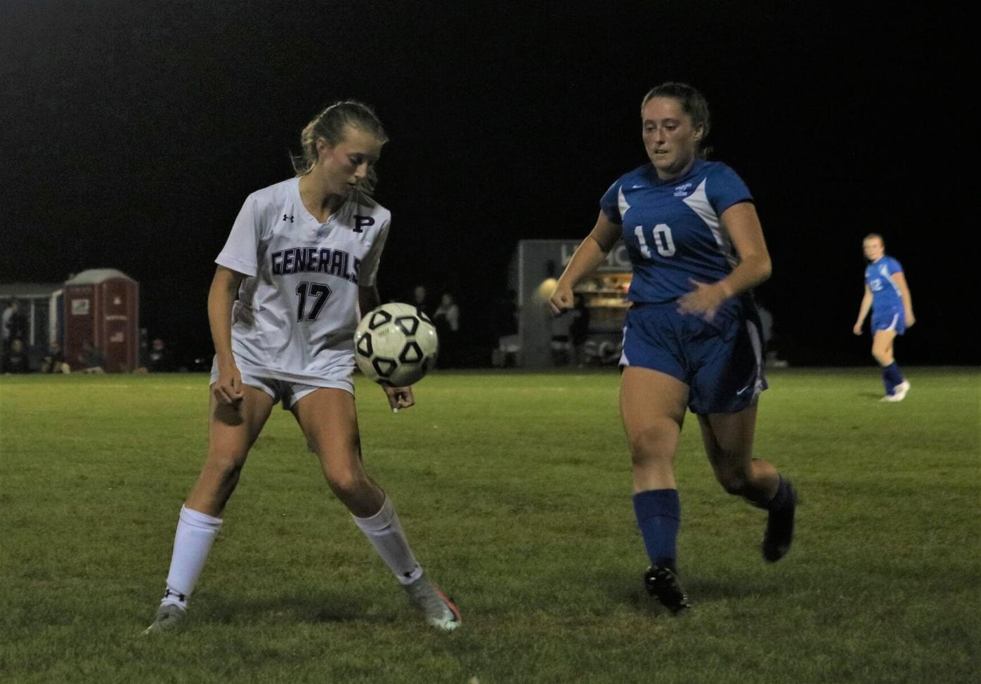 allie schnopp and claire naef play soccer
