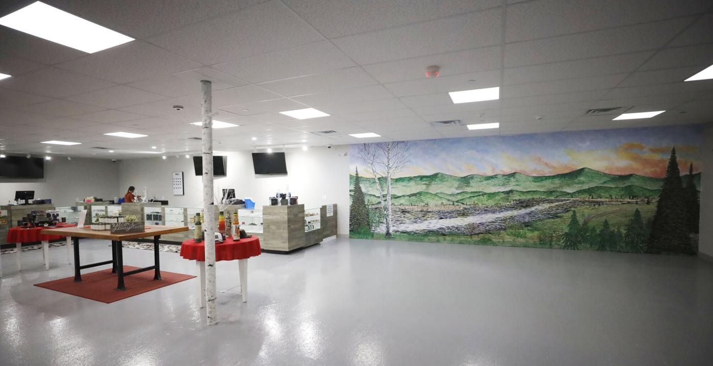 white room of dispensary with scenic mural