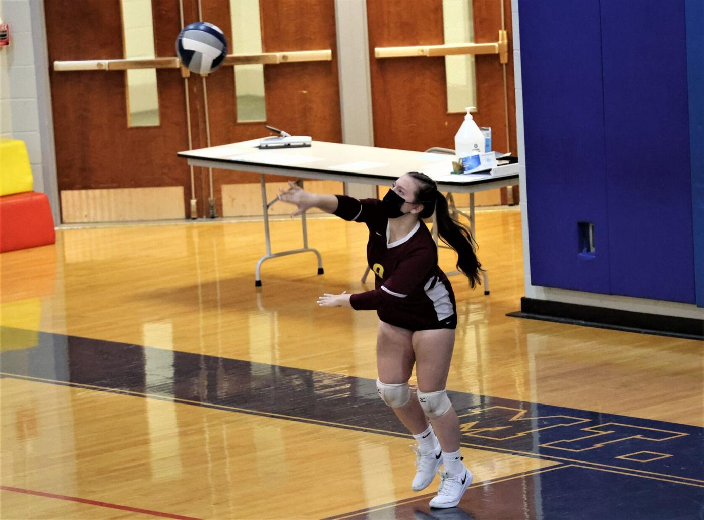 anna nealon serves the ball