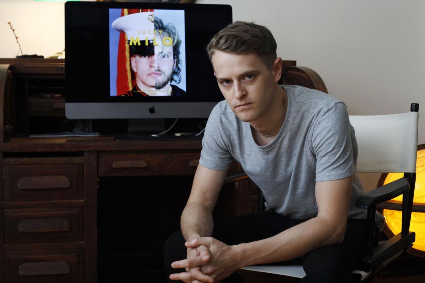filmmaker Edmund Milligan Marcus in front of Lucky Milo film on computer