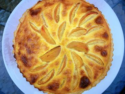 Peach tart on white plate