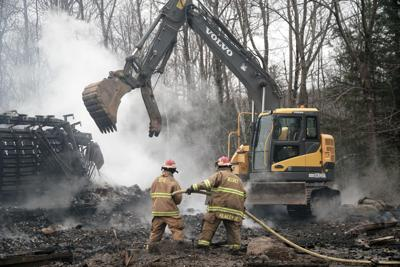 Firefighters work to snuff embers at Jacob's Pillow