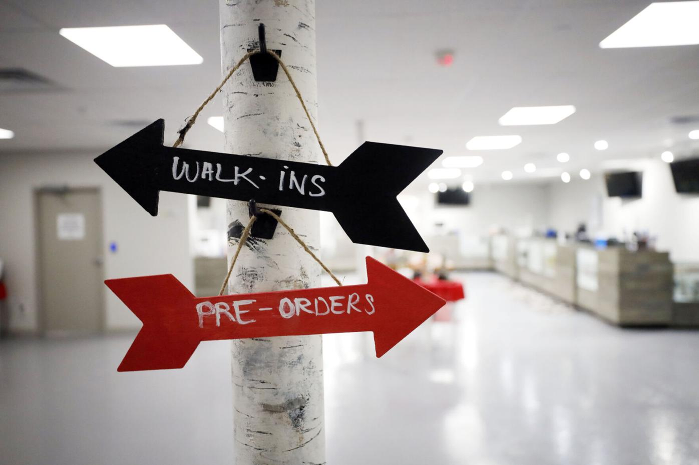 arrow signs for walk-ins and pre-orders at dispensary