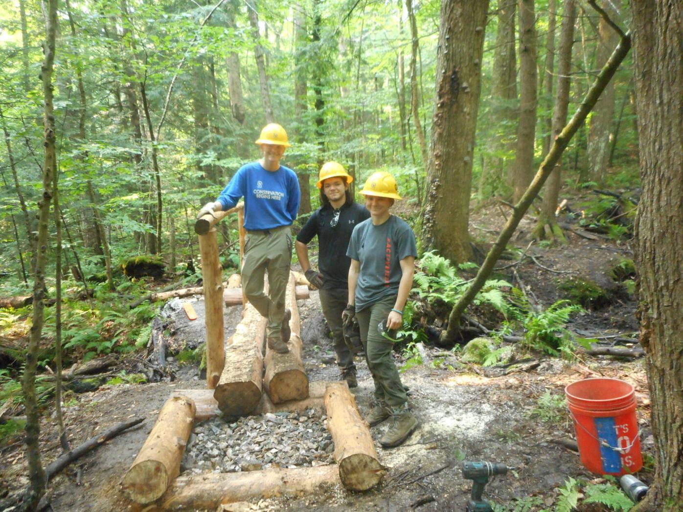 SCA crew building a bridge