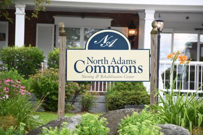 The sign and building of the North Adams Commons