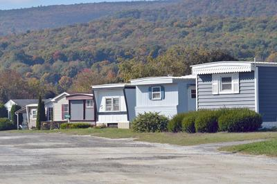 At Cheshire mobile home park, a rent cut, a rebate - but ...
