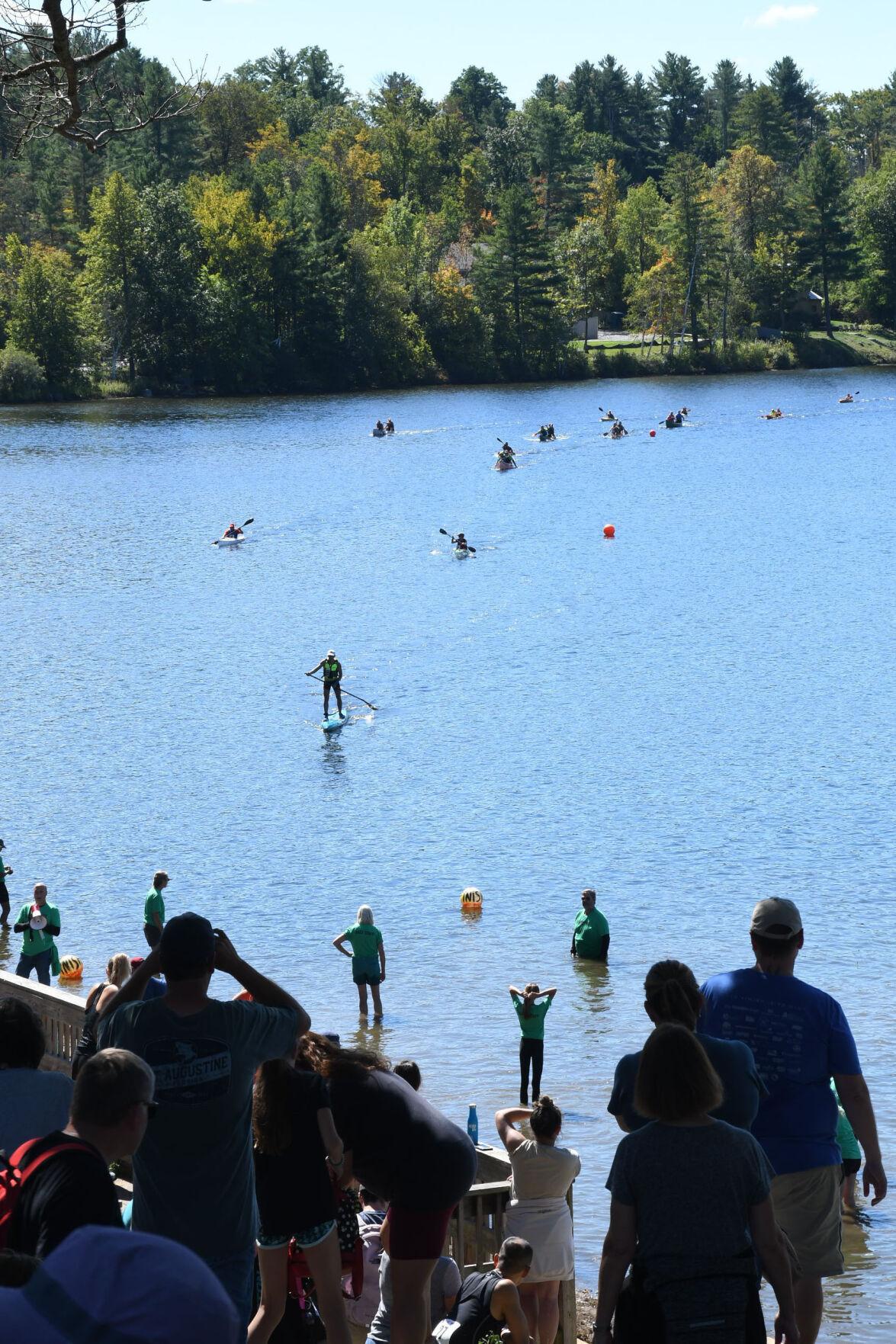 Spectators watch paddlers from Camp Mahkeenac