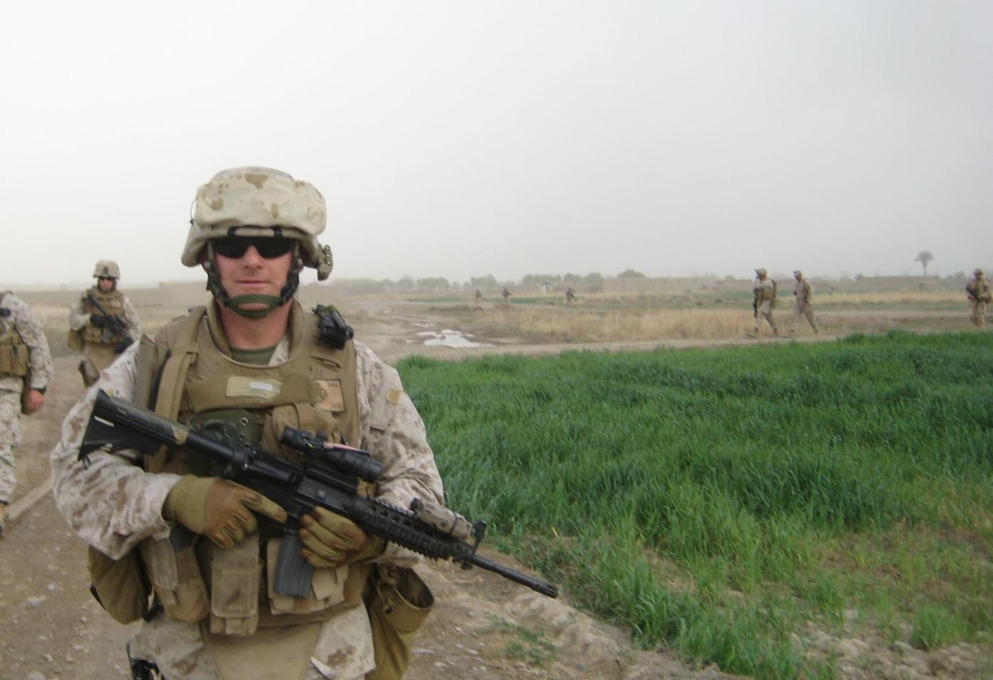 Steve Schultze in uniform holding a gun