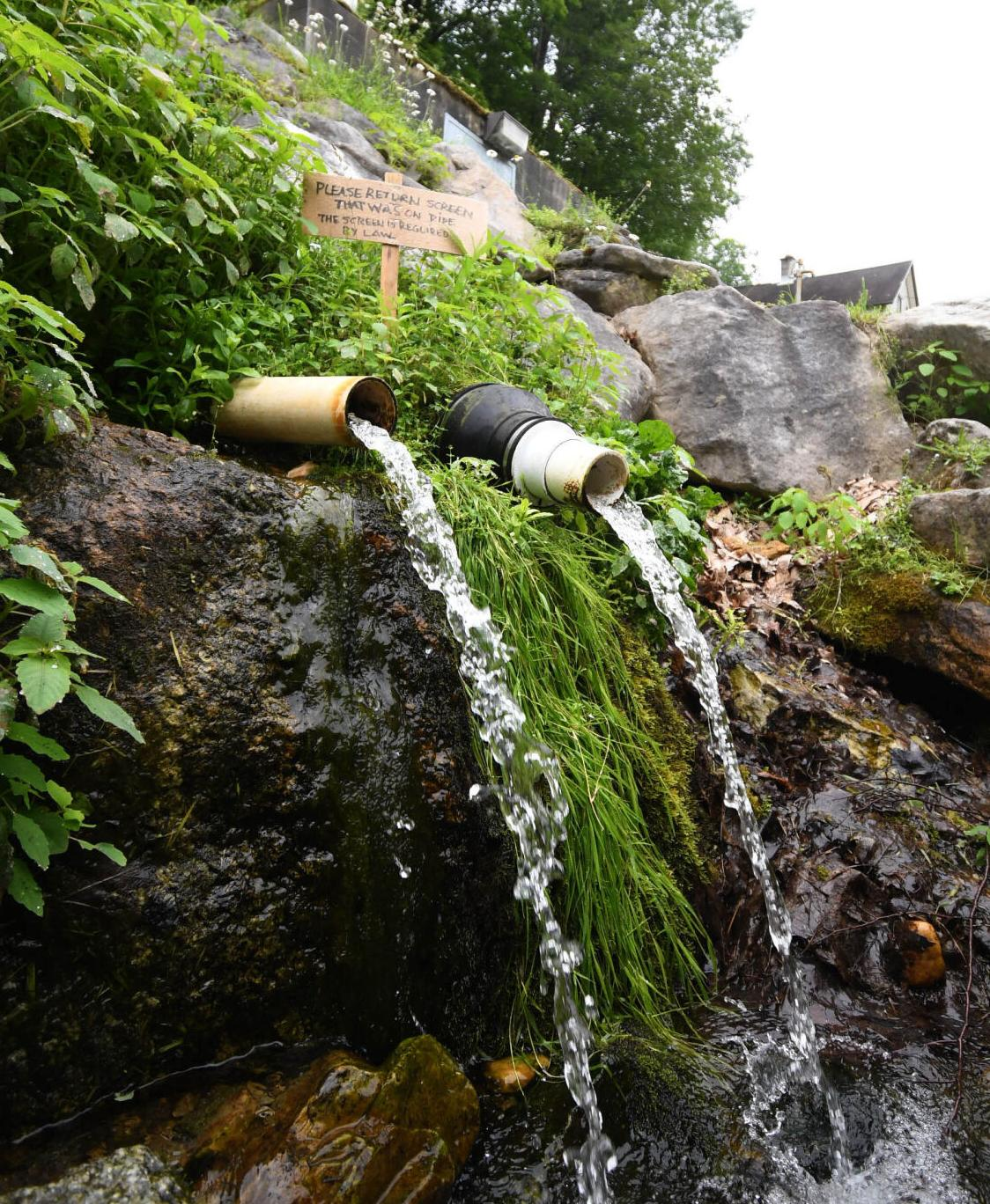 Spring water flows out of two spouts