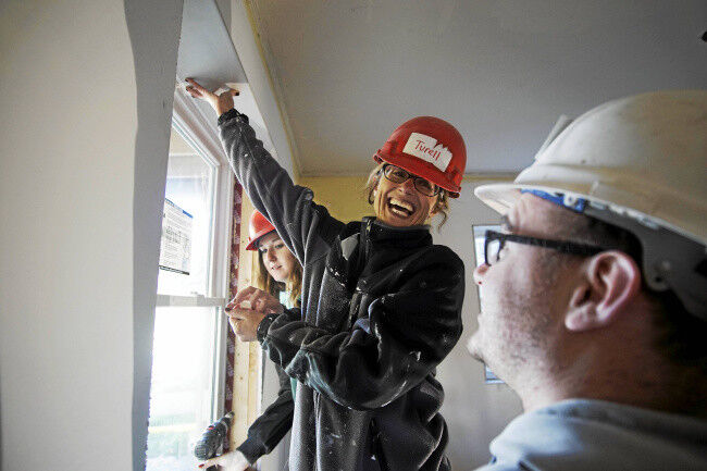 Country Curtains gives day to work on Habitat house