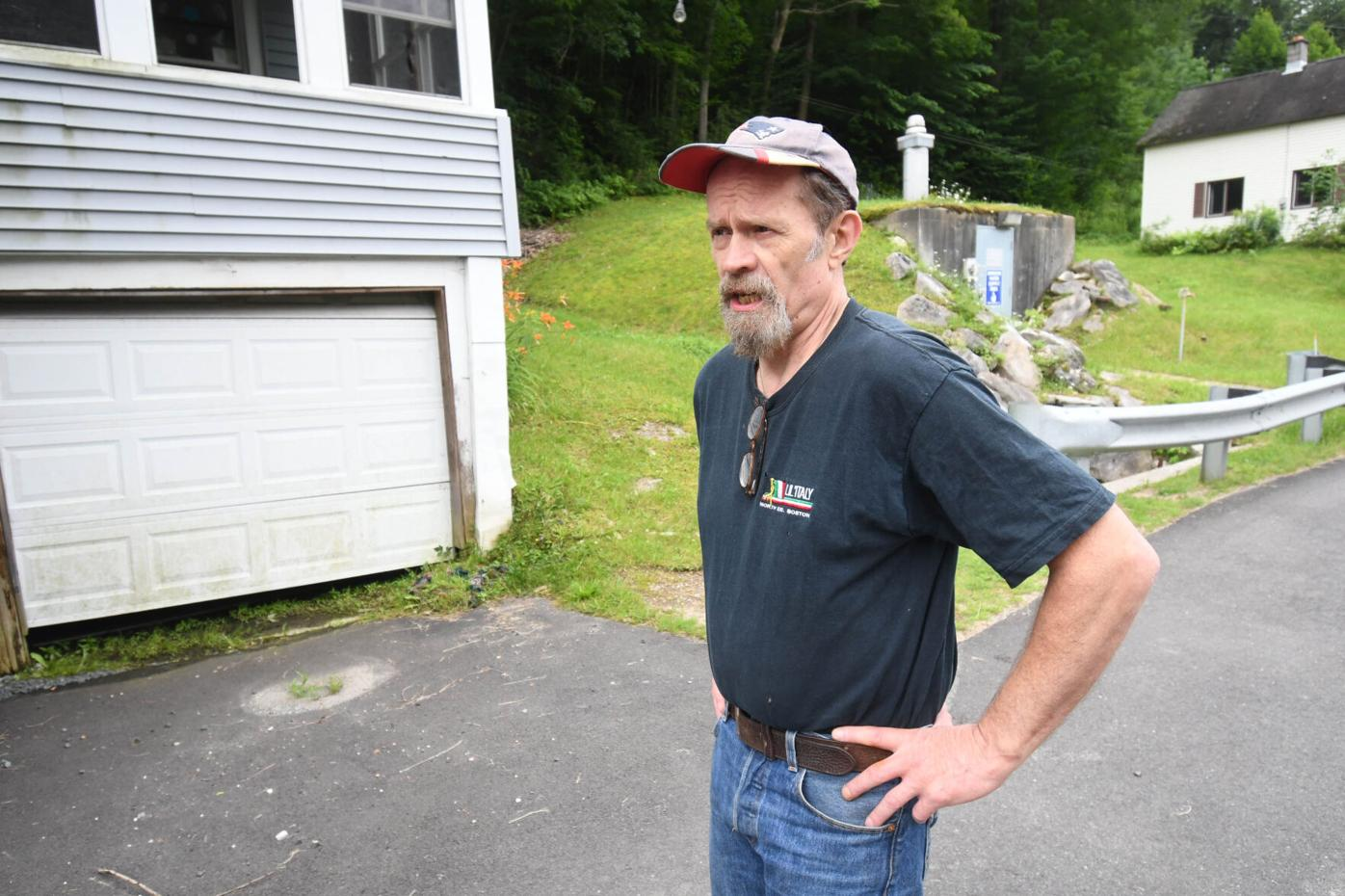 Carl McKinney stands in front of a garage