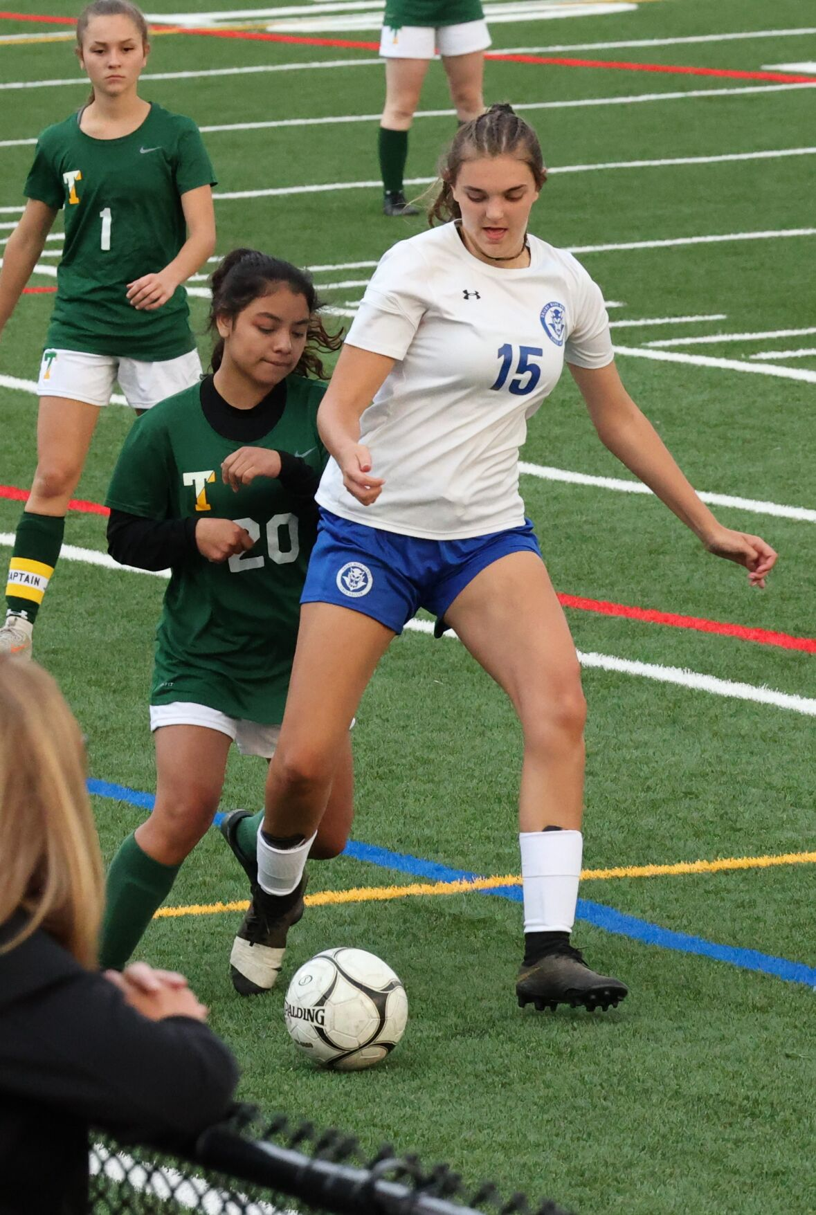alyssa russell and maria gonzalez go for the ball