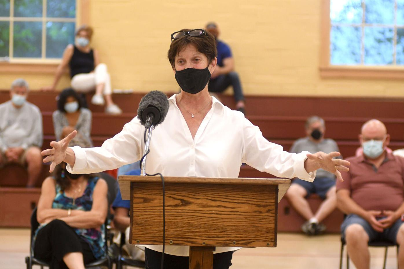 Amy Brentano speaks at the podium (copy)