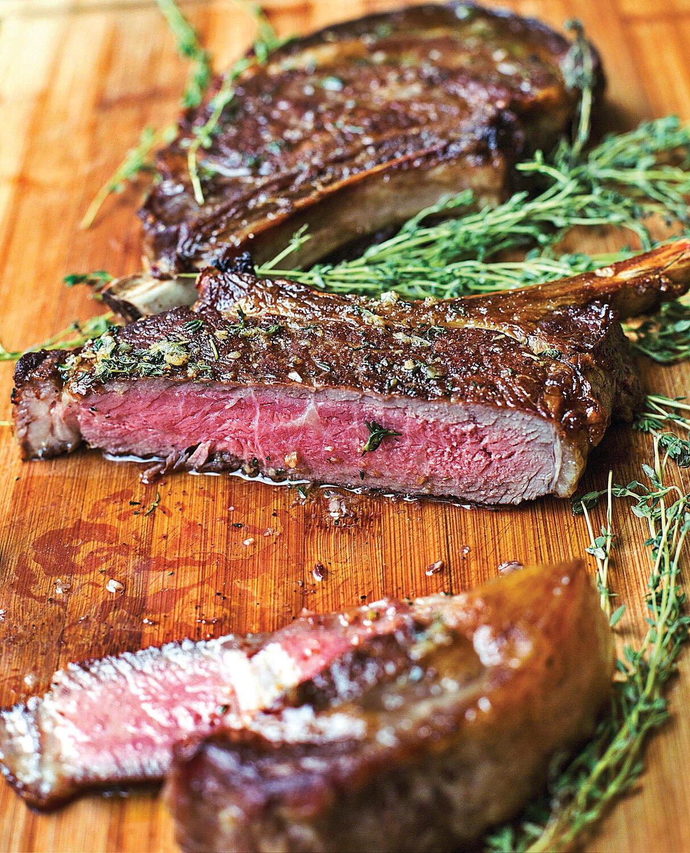Rib-eye steaks with thyme-garlic butter