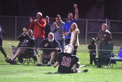 Caleb Harrington celebrates with fans