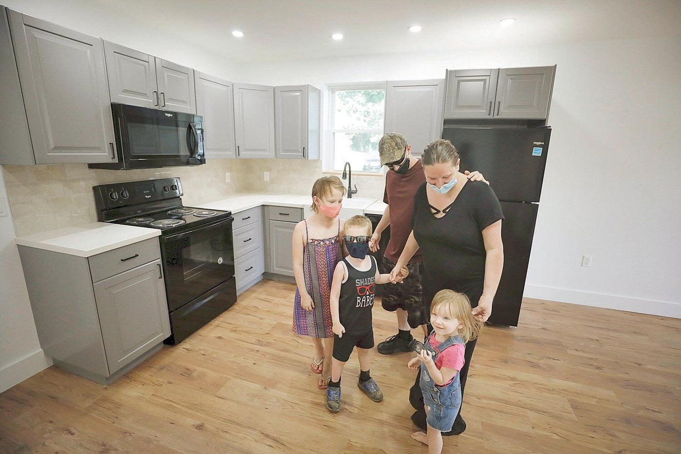 2 families now have houses to call home through Habitat for Humanity building blitz