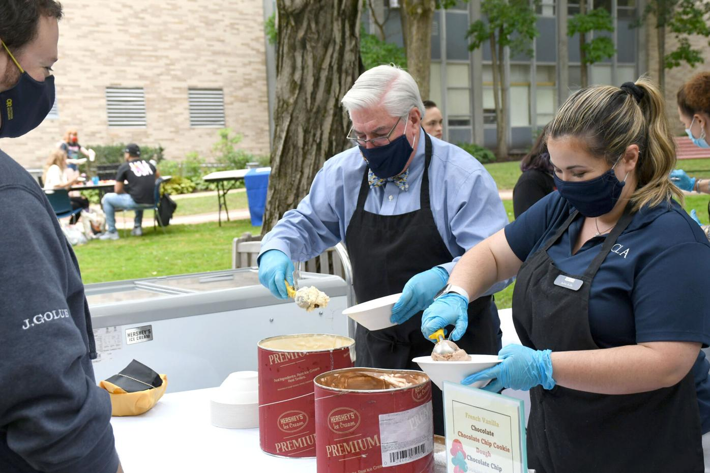 President Birge scoops ice cream with Jackie Kelly