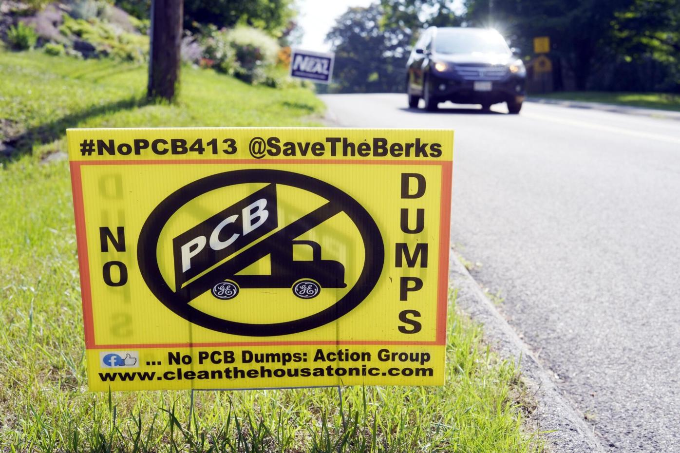 A lawn sign opposing a PCB dump site