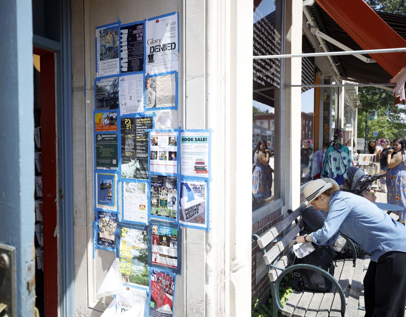 flyers taped in store doorway