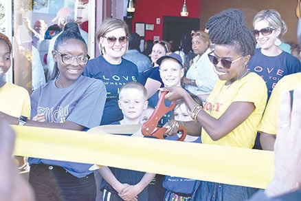Peace of Pizza ribbon cutting