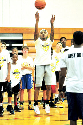 Tyler Ulis takes a three from the wing during his recent basketball camp at Marian  Catholic. A 2014 Marian graduate and a consensus first-team All-American ... 40a223b48
