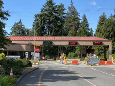 Exit lanes from Point Roberts, Wash., sit empty at the local Canadian border station, which was shut down to all but essential travel during the pandemic.