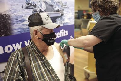 Veteran receives vaccine