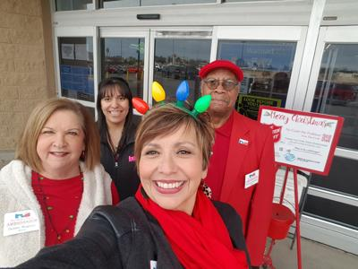 Ambassadors ringing Salvation Army Red Kettle Bell