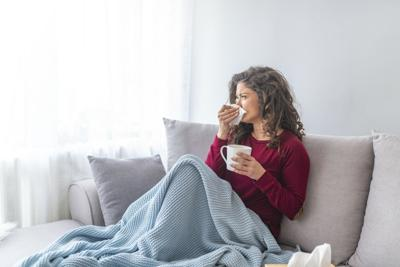 Sick desperate woman has flu.