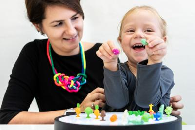Toddler girl in child occupational therapy session