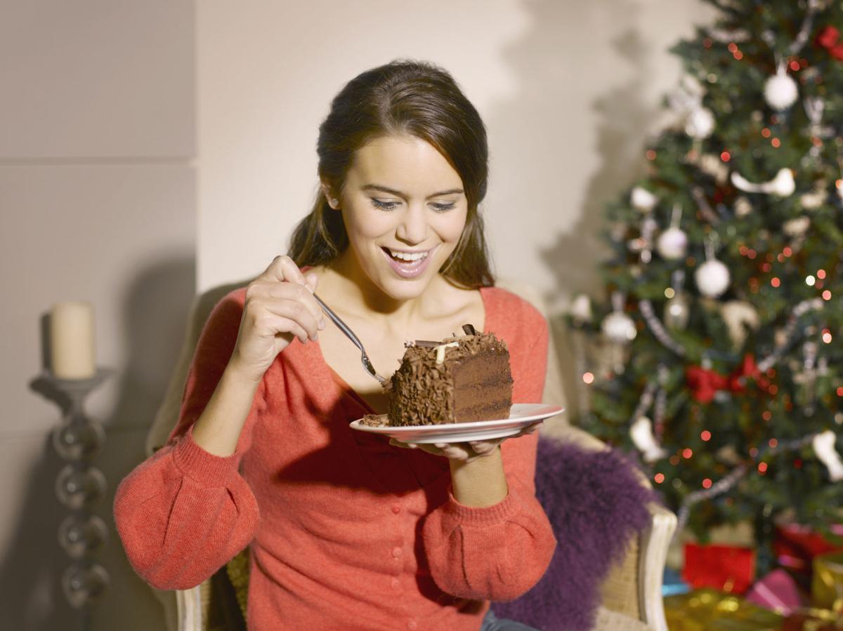 Woman eating cake at Christmas