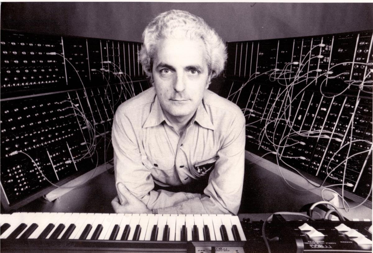 Bob Moog Leaning Over Roger Powell Keyboard_1974.jpg