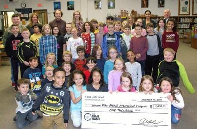 Dime Bank contributes to after school program