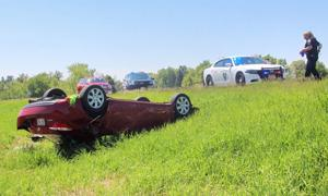 Two transported to hospital after sedan rolls over on Hwy. 53