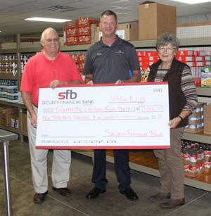 Security Financial Bank Donates $10,000 To Local Food Pantry