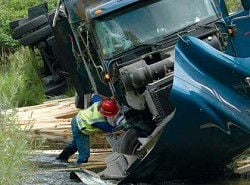Truck misses curve, unloads in creek