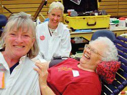 Volunteers roll up sleeves to helpRed Cross exceeds goal in blood drive
