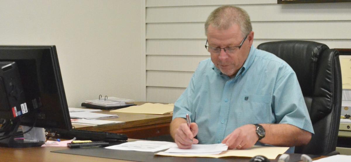 Bob Quinton sitting at his desk