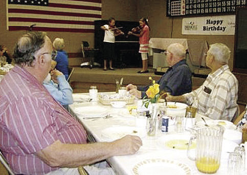 Students and seniors meet over salmon