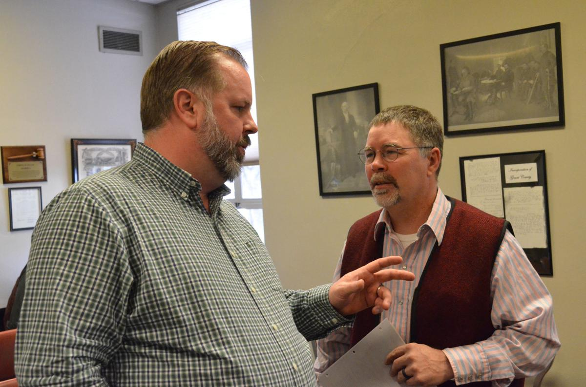 Commissioner Rob Raschio and Commissioner-elect Sam Palmer